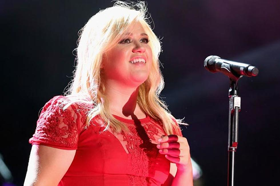 Kelly Clarkson and Family Get Wrapped in Red in Christmas Photo